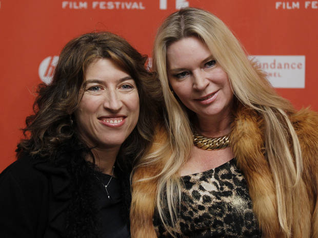 "FILE - In this Jan. 19, 2012 file photo, filmmaker Lauren Greenfield, left, and documentary subject Jacqueline Siegel, pose together at the opening night premiere of ""The Queen of Versailles"" at the 2012 Sundance Film Festival in Park City, Utah. (AP Photo/Danny Moloshok, File)"
