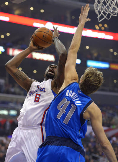 Los Angeles Clippers center DeAndre Jordan (6) shoots as Dallas Mavericks forward Dirk Nowitzki, of Germany, defends during the first half of their NBA basketball game, Wednesday, Jan. 9, 2013, in Los Angeles. (AP Photo/Mark J. Terrill)