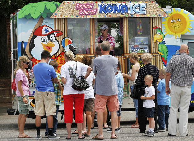 Visitors line up for cold treats at the Bethany 66 Festival in a parking lot in the city's downtown area Saturday,  May 26,  2012,  Photo by Jim Beckel, The Oklahoman