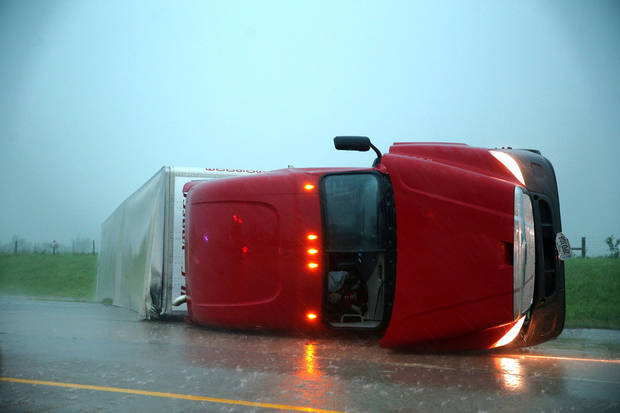 EL RENO, OK - An overturned semi rests on its side on the eastbound lanes of I-40, just east of el Reno, OK., after a tornado touched down Friday, May 31, 2013.