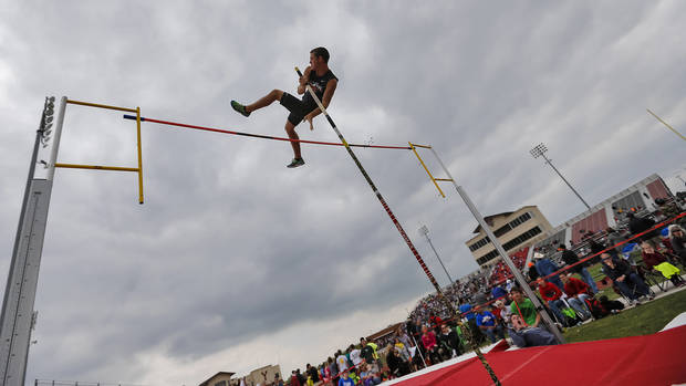 Coweta's Trent Lawerence competes in the pole vault during the class 5A and 6A track state championships at Yukon High School on on Friday, May 10, 2013, in Yukon, Okla.Photo by Chris Landsberger, The Oklahoman