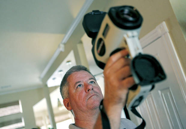 Dan Ward, a project engineer with Guaranteed Watt Saver, demonstrates how he uses an infrared camera to perform an energy evaluation at a home. Photos by JOHN CLANTON, The Oklahoman