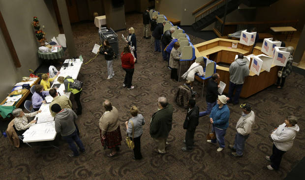Voters in Precinct 39 wait in line for their ballots before casting their vote on Election Day, Tuesday, Nov. 6, 2012, at the First Church of the Open Bible in Des Moines, Iowa. (AP Photo/Charlie Neibergall)