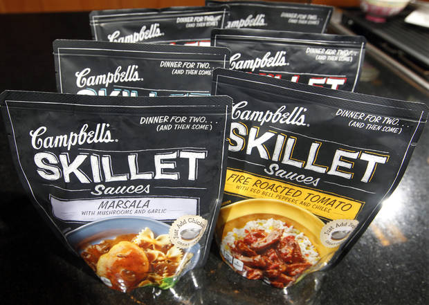 In this Friday, Aug. 24, 2012 photo, Campbell&#039;s new Skillet sauces are displayed at the Campbell Soup Company headquarters in Camden, N.J. As more people try their hand at mimicking sophisticated recipes from cooking shows and blogs, food companies are rolling out meal kits and starters that make amateur chefs feel like Emeril Lagasse or Rachael Ray in the kitchen. (AP Photo/Mel Evans)