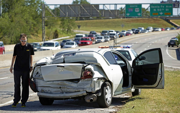 Nate Nickelsen walks beside his car after a wreck on Broadway Extension in Oklahoma CIty, Friday, September 3, 2010.  Photo by Bryan Terry, The Oklahoman