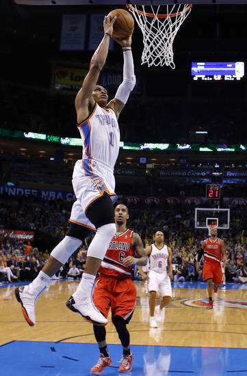 Oklahoma City's Russell Westbrook (0) dunks in front of Portland's Eric Maynor (6) during the NBA basketball game between the Oklahoma City Thunder and the Portland Trail Blazers at the Chesapeake Energy Arena in Oklahoma City, Sunday, March, 24, 2013. Photo by Sarah Phipps, The Oklahoman