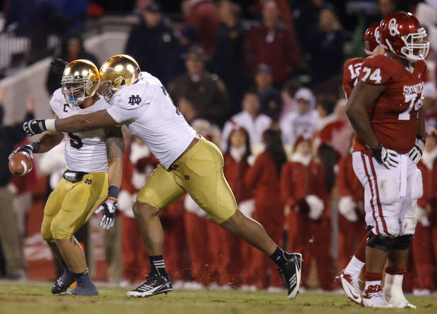 Notre Dame's Manti Te'o (5) and Stephon Tuitt (7) celebrate after an interception during the college football game between the University of Oklahoma Sooners (OU) and the Notre Dame Fighting Irish at Gaylord Family-Oklahoma Memorial Stadium in Norman, Okla., Saturday, Oct. 27, 2012. Oklahoma lost 30-13. Photo by Bryan Terry, The Oklahoman