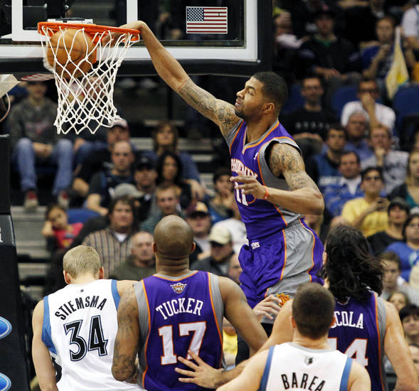Phoenix Suns forward Markieff Morris (11) dunks the ball against the Minnesota Timberwolves during the first half of an NBA basketball game, Saturday, Dec. 29, 2012, in Minneapolis. (AP Photo/Genevieve Ross)