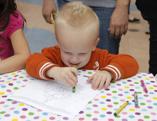 Levi Wilson, 2, of Oklahoma City, colors during Malee's first birthday celebration at the Oklahoma City Zoo, Sunday, April 15, 2012.  Photo by Garett Fisbeck, For The Oklahoman