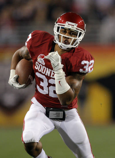 Oklahoma's Jamell Fleming (32) returns an interception during the Insight Bowl college football game between the University of Oklahoma (OU) Sooners and the Iowa Hawkeyes at Sun Devil Stadium in Tempe, Ariz., Friday, Dec. 30, 2011. Photo by Sarah Phipps, The Oklahoman