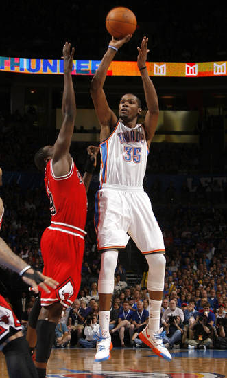 Oklahoma City's Kevin Durant (35) shoots over Chicago's Luol Deng (9) during the NBA basketball game between the Chicago Bulls and the Oklahoma City Thunder at Chesapeake Energy Arena in Oklahoma City, Sunday, April 1, 2012. Photo by Sarah Phipps, The Oklahoman