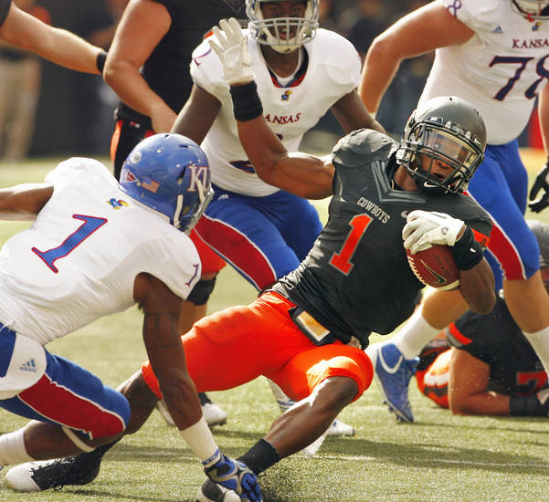 Oklahoma State's Joseph Randle (1) runs in the second quarter during a college football game between the Oklahoma State University Cowboys (OSU) and the University of Kansas Jayhawks (KU) at Boone Pickens Stadium in Stillwater, Okla., Saturday, Oct. 8, 2011 Photo by Steve Sisney, The Oklahoman