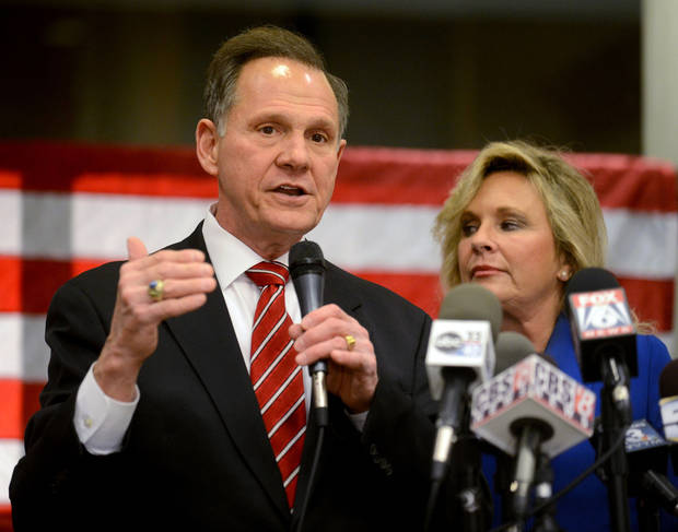 Chief Justice candidate Roy Moore speaks to the media after arriving at his headquarters Tuesday, Nov. 6, 2012, in Montgomery, Ala. He faces Democratic challenger Robert Vance. (AP Photo/The Montgomery Advertiser, Julie Bennett) NO SALES