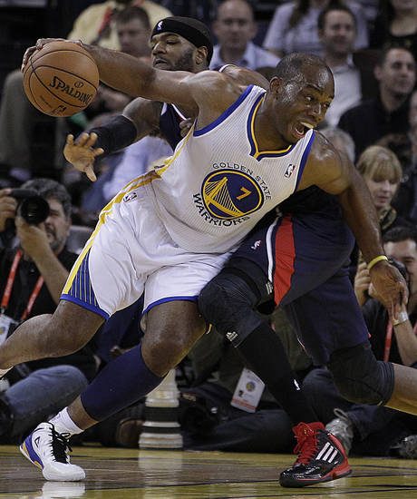 Golden State Warriors' Carl Landry (7) drives the ball away from Atlanta Hawks' Josh Smith during the first half of an NBA basketball game Wednesday, Nov. 14, 2012, in Oakland, Calif. (AP Photo/Ben Margot)