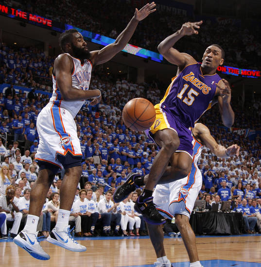 Los Angeles' Metta World Peace loses the ball as he is fouled beside Oklahoma City's James Harden (13) during Game 2 in the second round of the NBA playoffs between the Oklahoma City Thunder and L.A. Lakers at Chesapeake Energy Arena in Oklahoma City, Wednesday, May 16, 2012. Oklahoma City won 77-75. Photo by Bryan Terry, The Oklahoman