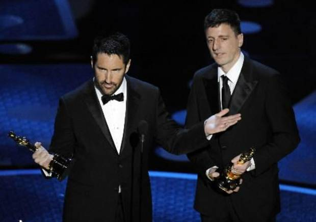 "Trent Reznor of Nine Inch Nails, left, and Atticus Ross accept the best original score Oscar for ""The Social Network."""