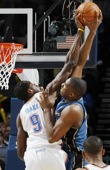 Oklahoma City's Serge Ibaka (9) blocks the shot of Washington's Kevin Seraphin (13) during the NBA basketball game between the Washington Wizards and the Oklahoma City Thunder at the Oklahoma City Arena in Oklahoma City, Friday, January 28, 2011. Photo by Nate Billings, The Oklahoman
