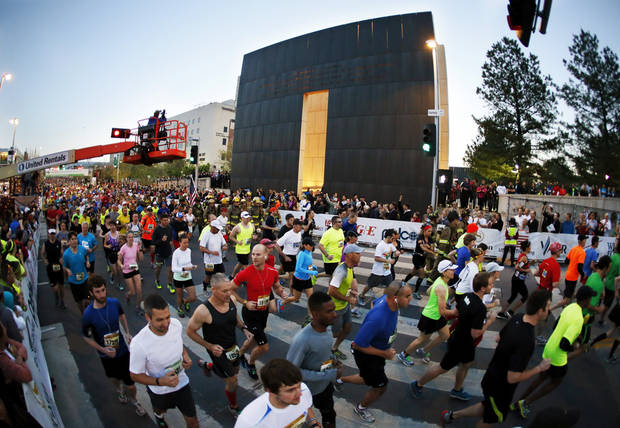 In this photo taken with a fisheye lens, runners pass the west gate of the Oklahoma City National Memorial as they travel south on Harvey Ave. during the Oklahoma City Memorial Marathon in Oklahoma City, Sunday, April 28, 2013. Photo by Nate Billings, The Oklahoman