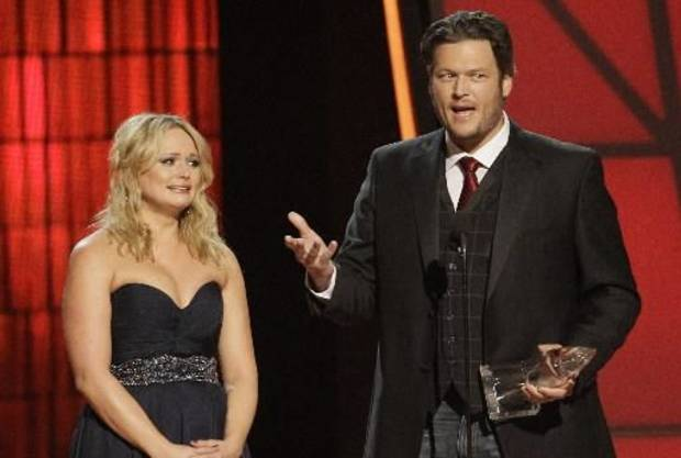Miranda Lambert and Blake Shelton accept the Country Music Association's Song of the Year honor last week at the 46th Annual CMA Awards in Nashville, Tenn. (AP file)
