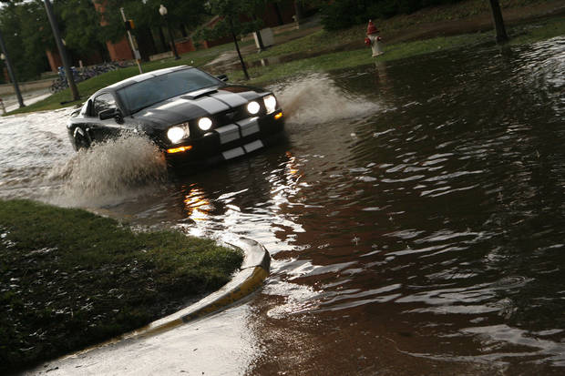 Cars struggle to make it through the flooding on Jenkins after the storm in Norman on Tuesday, June 14, 2011. Photo by Ashley R. West, The Oklahoman