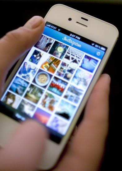 Instagram is used on an iPhone in New York. Facebook spent $1 billion to buy the photo-sharing company Instagram in the social network's largest acquisition ever. AP Photo <strong>Karly Domb Sadof</strong>
