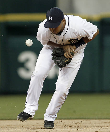 Detroit Tigers shortstop Jhonny Peralta bobbles a Seattle Mariners' Casper Wells ground ball in the third inning of a baseball game in Detroit, Wednesday, April 25, 2012. Peralta was charged with an error on the play. (AP Photo/Paul Sancya)