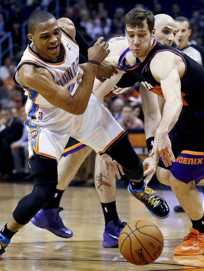 Phoenix Suns' Goran Dragic, right, of Slovenia, steals the ball from Oklahoma City Thunder's Russell Westbrook, left, during the first half in an NBA basketball game, Sunday, Feb. 10, 2013, in Phoenix. (AP Photo/Ross D. Franklin)