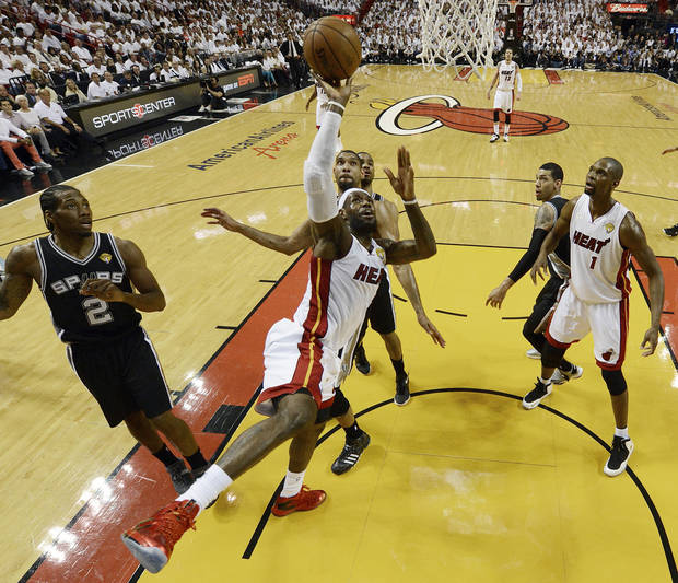 The Miami Heat's LeBron James (6) shoots against the San Antonio Spurs during the first half in Game 7 of the NBA basketball championships,  Thursday, June 20, 2013, in Miami. (AP Photo/Steve Mitchell, Pool)