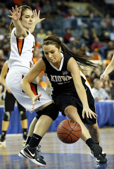 Kiowa's Lauren Smith (20) drives past Cheyenne-Reydon's Summer Pennington (30) during a Class A girls semifinal game of the state high school basketball tournament between Cheyenne-Reydon and Kiowa at Jim Norick Arena, The Big House, on State Fair Park in Oklahoma City, Friday, March 1, 2013. Photo by Nate Billings, The Oklahoman