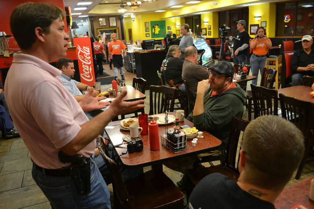 Bryan Hull, a founding director of Oklahoma Open Carry Association, addresses a crowd that showed up at Beverly's Pancake House at midnight Thursday to mark the state's transition from a concealed carry one to an open carry one. <strong>By Zeke Campfield - THE OKLAHOMAN</strong>