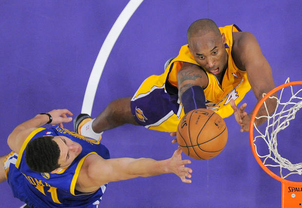 Los Angeles Lakers guard Kobe Bryant, right, puts up a shot as Golden State Warriors guard Klay Thompson defends during the first half of their NBA basketball game, Friday, Nov. 9, 2012, in Los Angeles. (AP Photo/Mark J. Terrill)