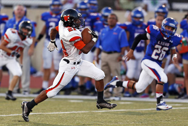 Norman's Imond Robinson (21) carries the ball on a long touchdown run during a high school football game between Moore and Norman in Moore, Okla., Thursday, Sept. 6, 2012. Photo by Nate Billings, The Oklahoman