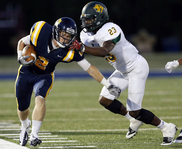 UCO's Christian Hood tries to get by Missouri Southern's Brian Rodgers during the college football game between the University of Central Oklahoma and Missouri Southern at Wantland Stadium in Edmond, Okla., Thursday, Aug. 30, 2012. Photo by Sarah Phipps, The Oklahoman KOD