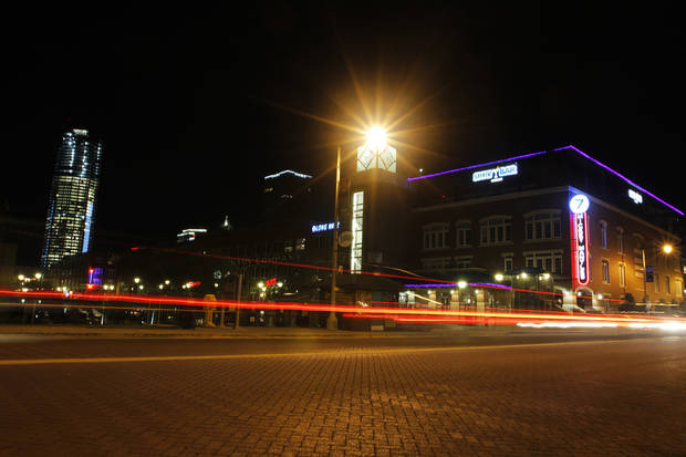 Cars drive by in the Bricktown area in Oklahoma City, Saturday, March 24, 2012.  There have been several assaults near bars in Bricktown the last eight months.  Photo by Garett Fisbeck, For The Oklahoman