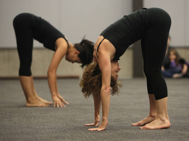 Kim Kieffer and Maria Krey,  with Perpetual Motion dance company, perform at the  Patience S. Latting Northwest Library in Oklahoma City.  Photo by Garett Fisbeck, The Oklahoman <strong>Garett Fisbeck - Garett Fisbeck</strong>