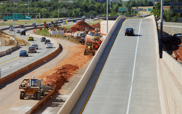 A vehicle on the right taking the new exit ramp to go from southbound I-235 to westbound I-44 in Oklahoma City Friday July 20, 2012. Southbound I-235 traffic is at left with the construction zone in the center. Photo by Paul B. Southerland, The Oklahoman