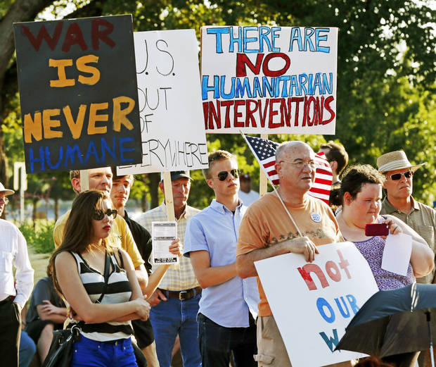 People listen to speakers during a nonpartisan rally against the United States' involvement in the Syrian civil war, on the south side of state Capitol in Oklahoma City, Friday, July 12, 2013. Photo by Nate Billings, The Oklahoman
