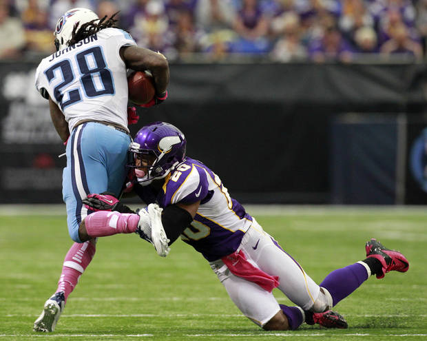Minnesota Vikings cornerback Chris Cook, right, tackles Tennessee Titans running back Chris Johnson during the first half of an NFL football game on Sunday, Oct. 7, 2012, in Minneapolis. (AP Photo/Genevieve Ross)