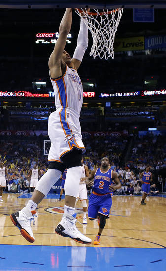 Oklahoma City's Russell Westbrook (0) dunks the ball in front of New YorK's Raymond Felton (2) during NBA basketball game between the Oklahoma City Thunder and the New York Knicks at the Chesapeake Energy Arena, Sunday, April 7, 2010, in Oklahoma City Photo by Sarah Phipps, The Oklahoman