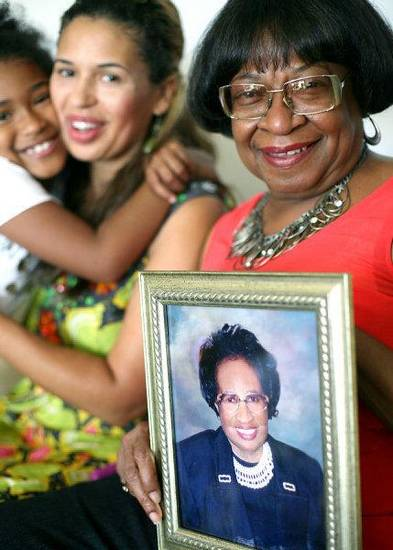 Marilyn Hildreth (right) holds a picture of her mother Clara Luper as she and her sister Chelle Luper Wilson and her daughter Sasha Wilson (far left) talk about Clara Luper at her home in Oklahoma City on Wednesday.  <strong>JOHN CLANTON - JOHN CLANTON</strong>