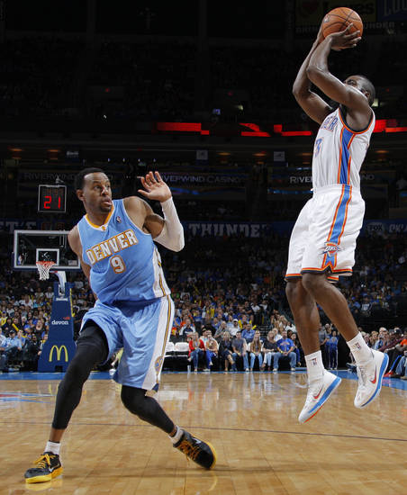 Oklahoma City's James Harden (13) takes a shot over Denver's Anthony Carter (5) during the NBA preseason basketball game between the Oklahoma City Thunder and the Denver Nuggets at the Chesapeake Energy Arena, Sunday, Oct. 21, 2012. Photo by Garett Fisbeck, The Oklahoman