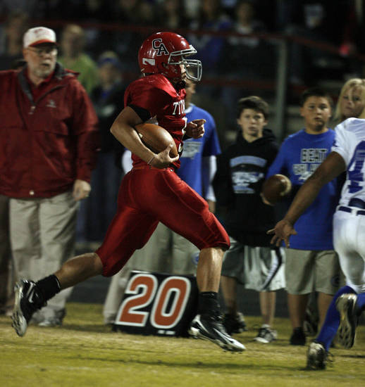 Carl Albert quarterback J. T. Realmuto runs out of bounds after a first and ten as the Titans play Guthrie in high school football at Jim Harris Stadium  in Midwest City, Oklahoma on Thursday October 16, 2008.  