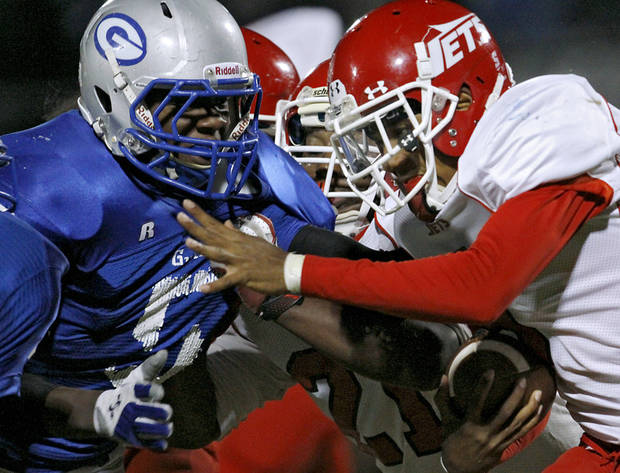 Western Heights' Juan Woods runs into Guthrie's Richard Brothers during their high school football game in Guthrie on Friday, Oct. 28, 2011. Photo by John Clanton, The Oklahoman