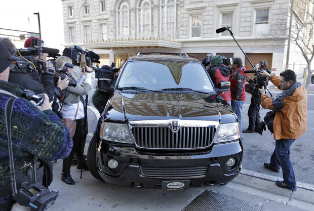Casey Anthony's vehicle is surrounded by the media as she arrives at the United States Courthouse for a bankruptcy hearing Monday, March 4, 2013, in Tampa, Fla. Anthony has not been seen in public since being acquitted in 2011 of murdering her two-year-old daughter Caylee. (AP Photo/Chris O'Meara)
