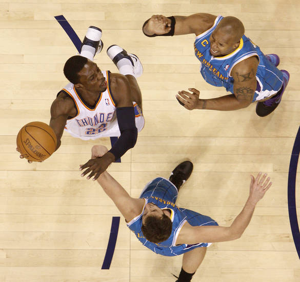 Oklahoma City's Jeff Green (22) shoots the ball between New Orleans' David West (30) and New Orleans' Marco Belinelli (8) during the NBA basketball game between the Oklahoma City Thunder and the New Orleans Hornets, Wednesday, Feb. 2, 2011 at the Oklahoma City Arena. Photo by Bryan Terry, The Oklahoman