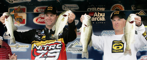 L to R - Kevin VanDam and Lance Peck hold up their catch at the Fish and Chips Bass Tournament. Weigh-in at Riverwind Casino. Photo by Jaconna Aguirre, The Oklahoman. ORG XMIT: KOD