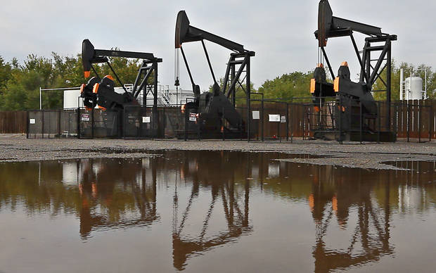These pumping units in Enid are owned by Continental Resources. Photo by David McDaniel, The Oklahoman