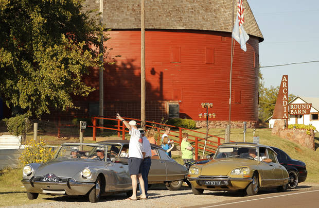 A group of tourists from Holland driving historic Route 66 in their classic cars they had shipped to America for the trip, made a stop at the Round Barn in Arcadia Saturday, October 12, 2013.  Photo by Doug Hoke, The Oklahoman