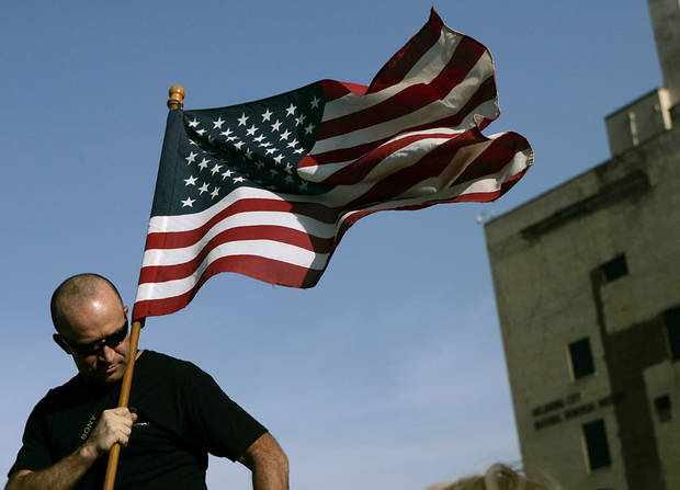 SSgt Ted Krey (Ret.) holds a flag outside the Oklahoma City National Memorial and Museum during the 16th Annual Day of Remembrance in Oklahoma City, Oklahoma on Tuesday, April 19, 2011. Photo by John Clanton, The Oklahoman