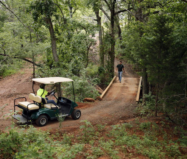 Workers make their way through Quail Ridge Sporting Clays on Friday, June 1, 2012, in Oklahoma City, Okla.  Photo by Steve Sisney, The Oklahoman